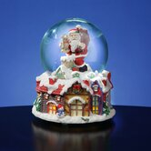 Santa with Lighted Victorian Village Snow Globe