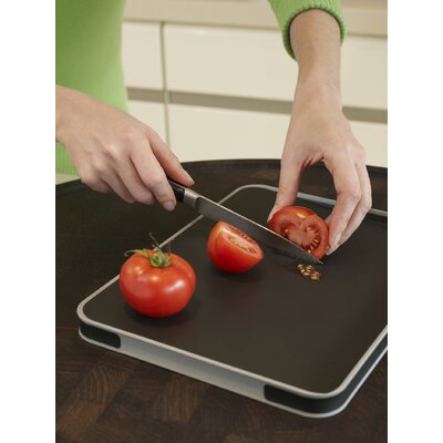 Joseph Joseph Small Cut and Carve Chopping Board in Black