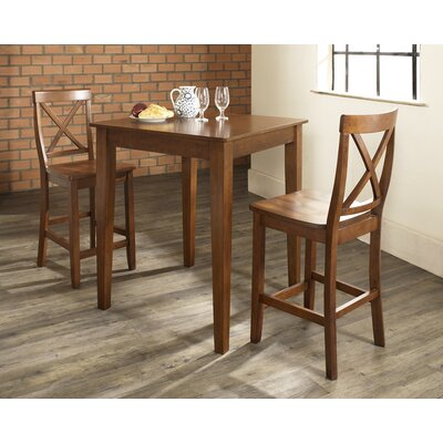 Crosley Three Piece Pub Dining Set with Tapered Leg Table and X-Back Barstools in Classic Cherry