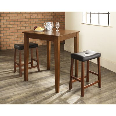 Crosley Three Piece Pub Dining Set with Tapered Leg Table and Saddle Seat Barstools in Classic Cherry